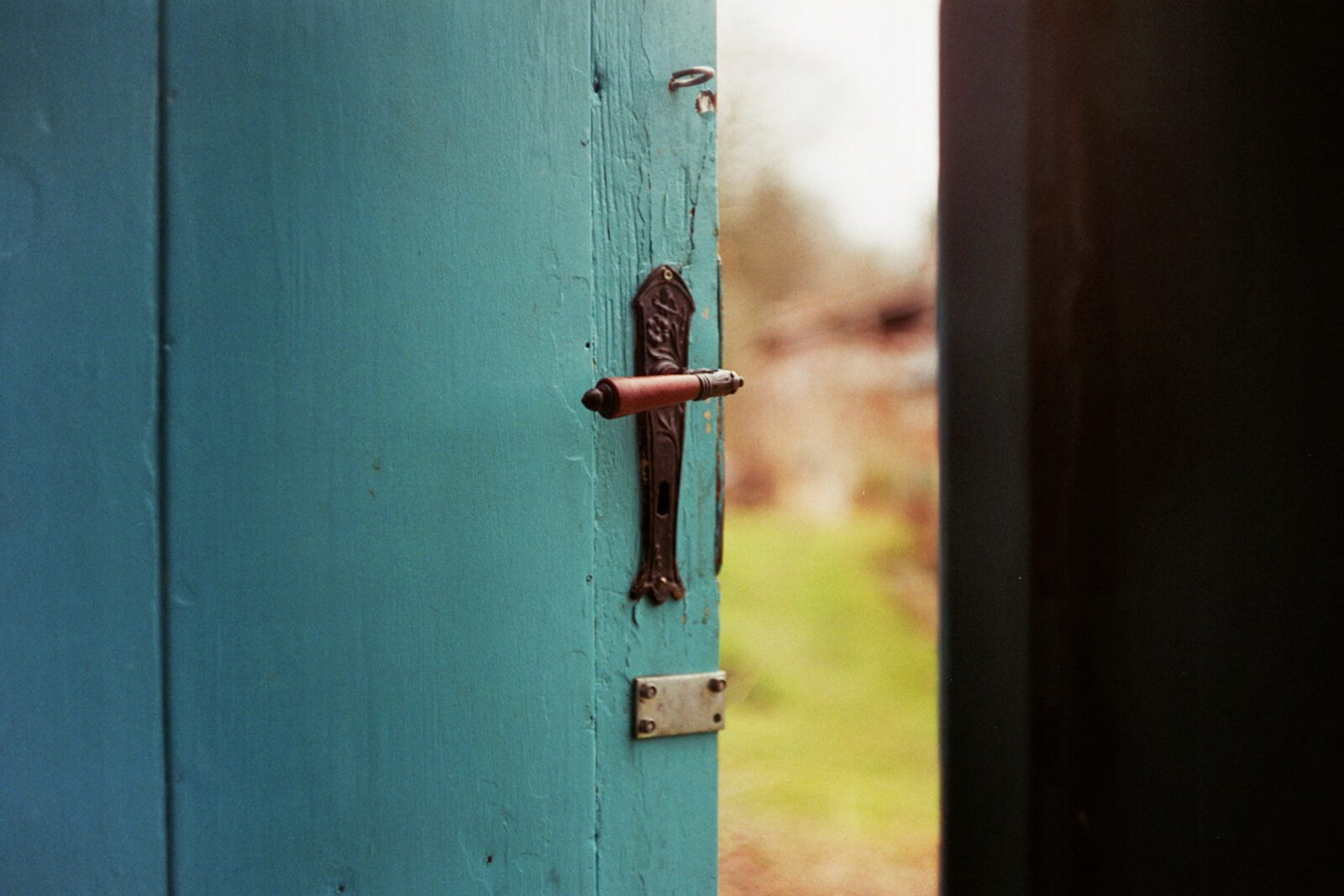 A blue door opening to the outside to demonstrate the endless opportunities that exist