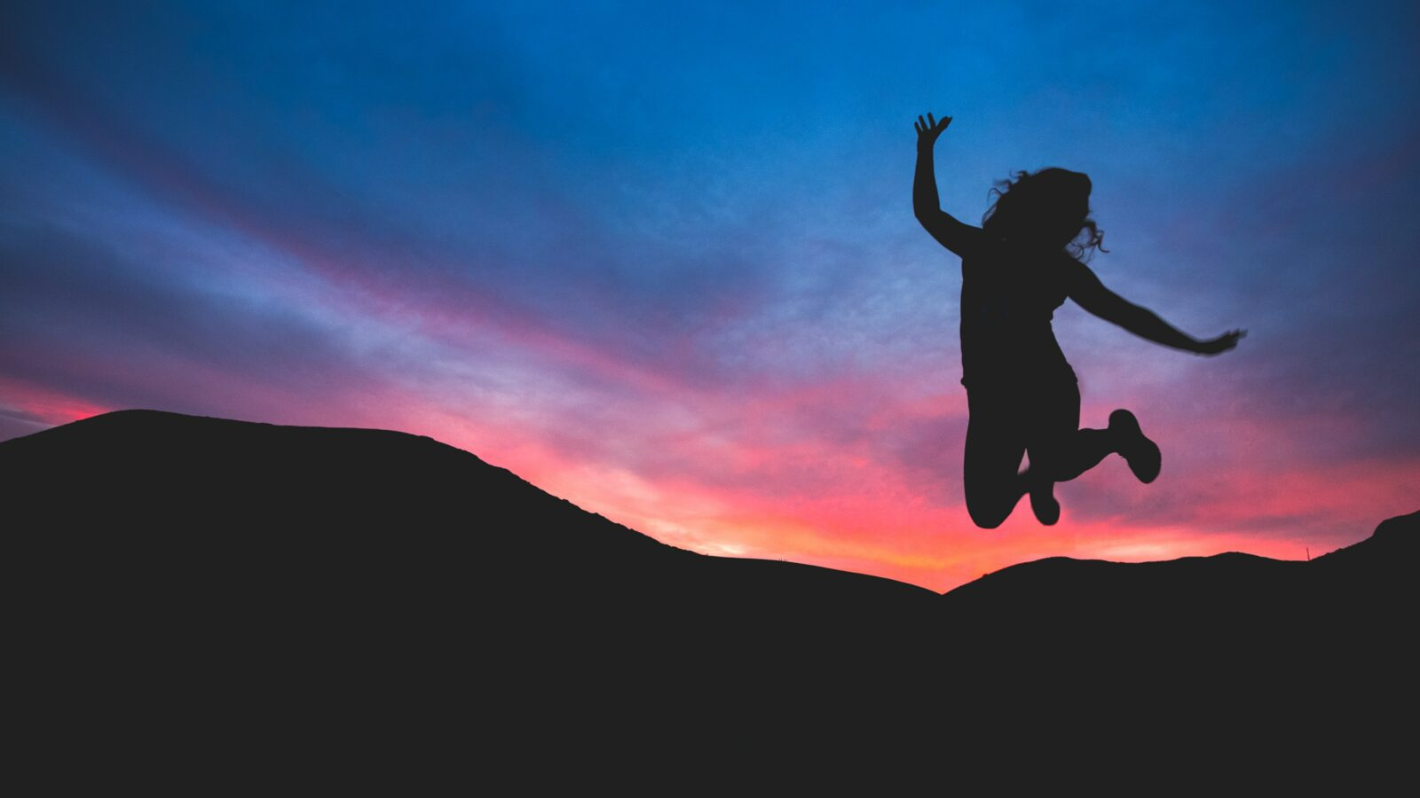 A silhouette of someone jumping into the air, demonstrating the power of becoming the voice of motivation