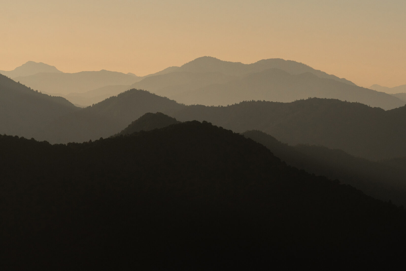 A gradient of earth-toned hilltop silohouettes