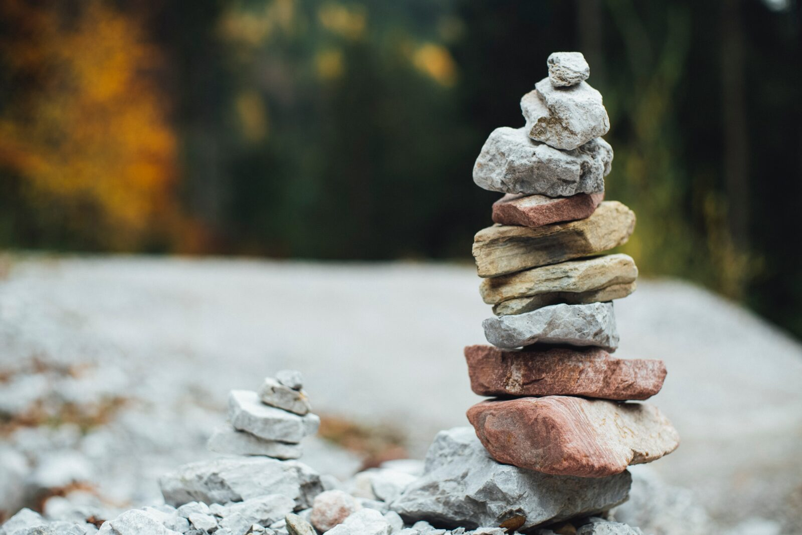 A pile of rocks sitting on one another demonstrating the value of balance while accepting the discomforts of life