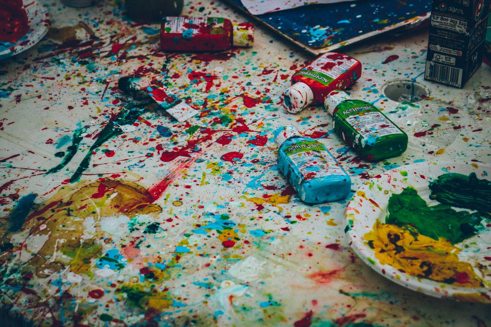Paint splatters and bottles on a floor